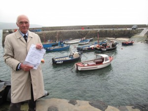 William Frisken, Coverack Harbour Chairman, receiving the offer letter awarding FLAG funding to carry out the harbour enhancements