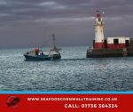 A fishing boat leaving harbour in Cornwall